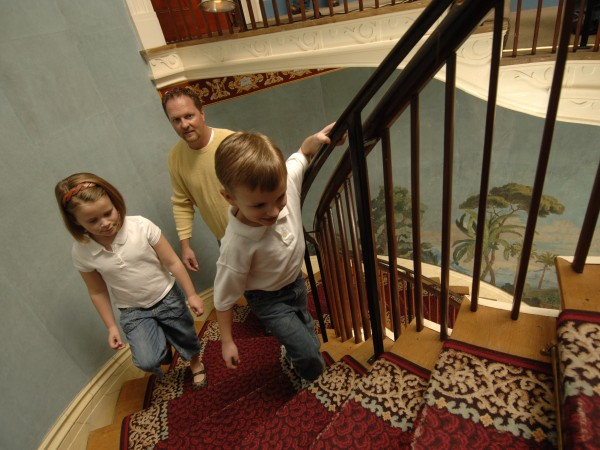 A Family Walks to the Second Floor of The Hermitage on a Tour