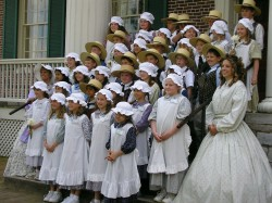 A Class of Students Poses in Character at The Hermitage on a Field Trip