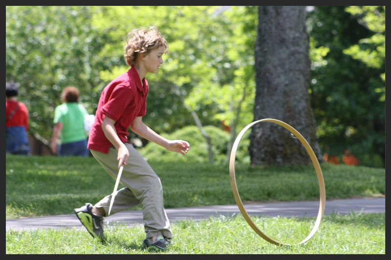 Student playing with the Hoop and Stick during an education program