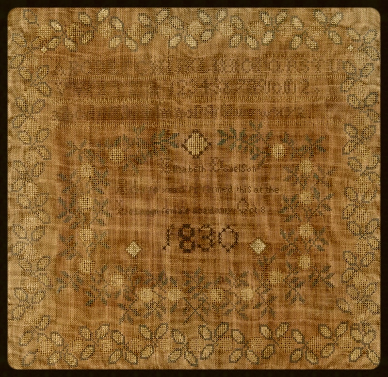 Cross stitched sampler of linenthread on linen canvas by Elizabeth Donelson