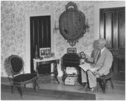Charles Lawrence Winn (1882-1967) in the early 1950s with some of the Jackson objects he inherited.