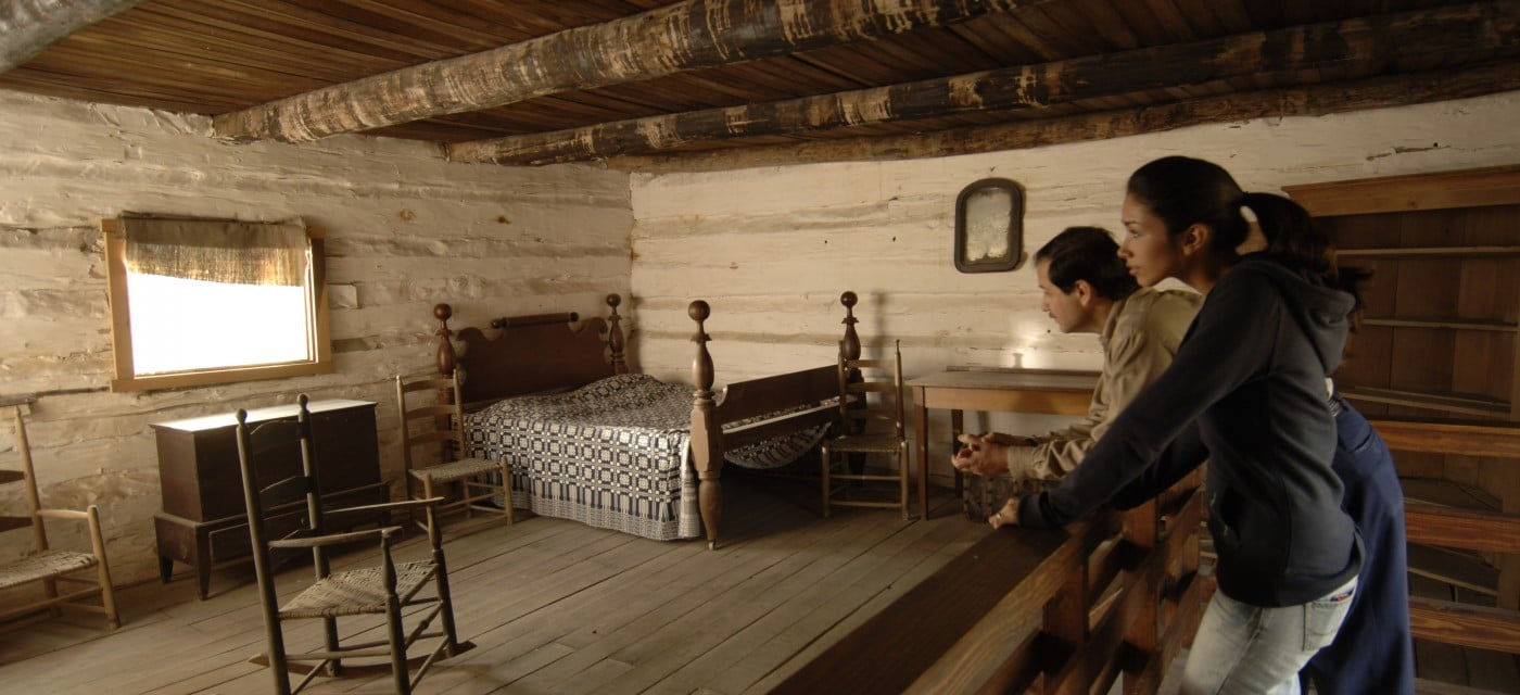 Visitors Inside Aflred's Cabin, a Slave Site at The Hermitage