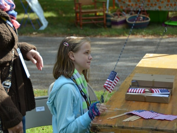 Student Holds an American Flag During a Field Trip to The Hermitage